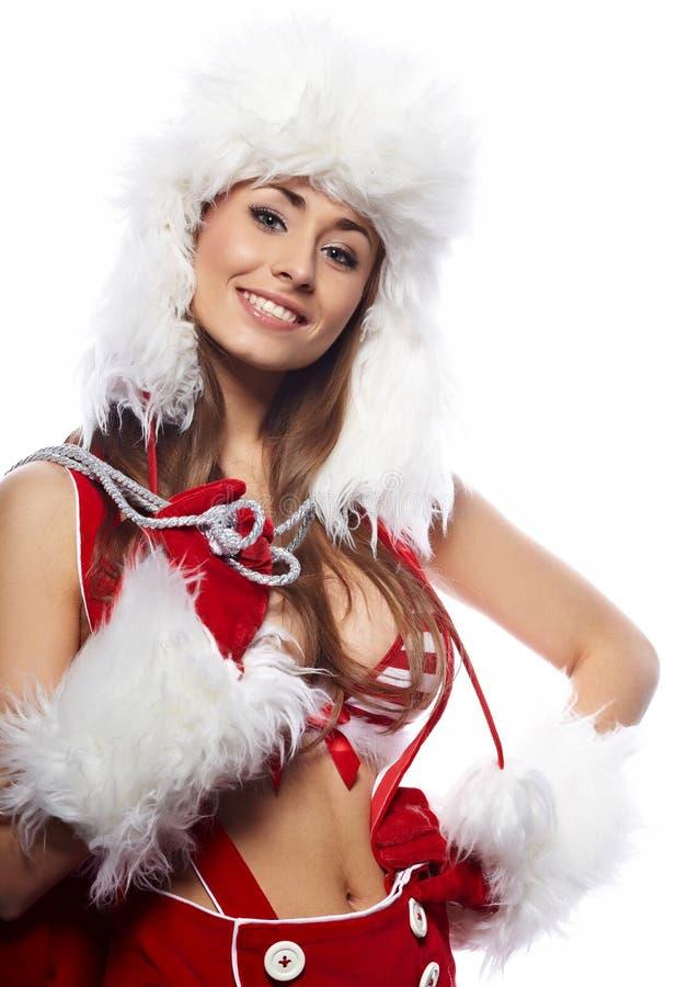 作为圣诞老人打扮的性感的新深色的妇女 库存照片