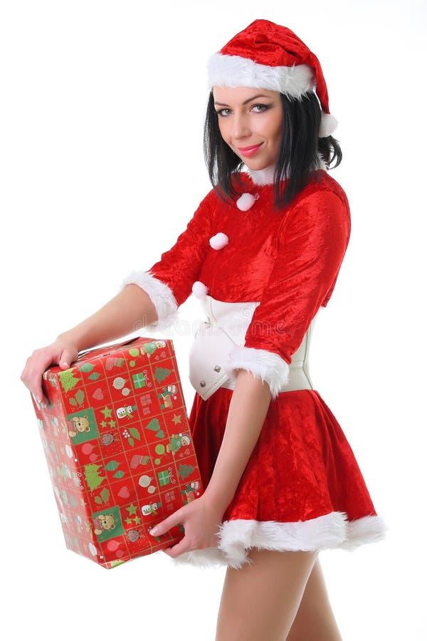 作为圣诞老人打扮的深色的妇女 库存图片