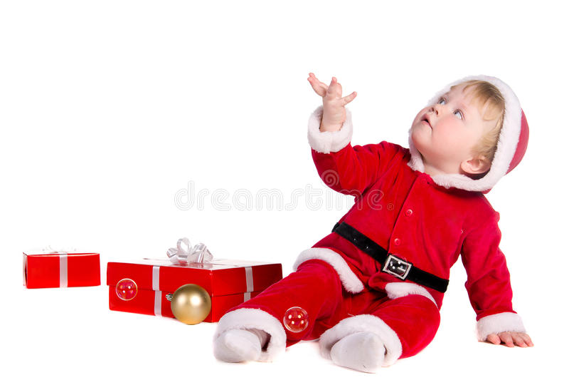 作为圣诞老人打扮的男孩 免版税库存图片