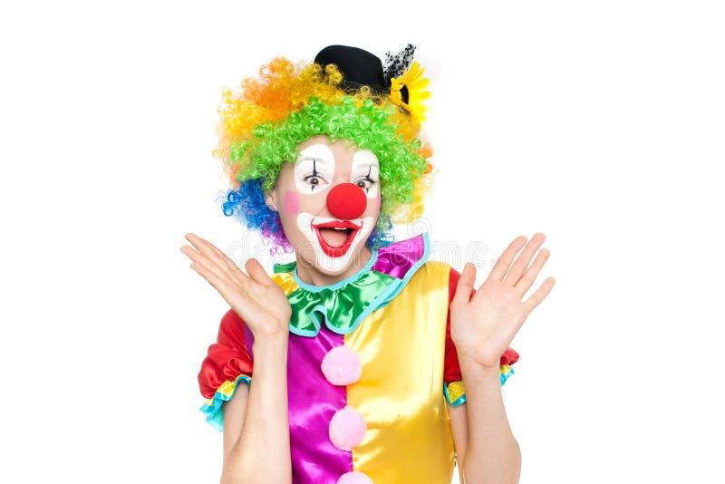 作为小丑的美丽的少妇 免版税库存照片