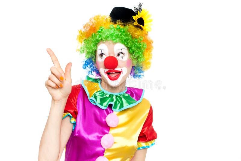 作为小丑的美丽的少妇 库存图片