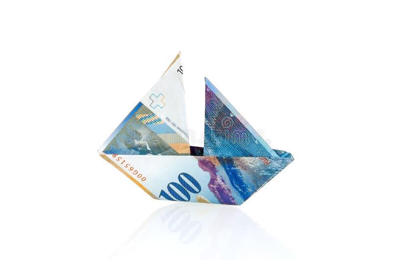 作为小船被折叠的瑞士法郎 免版税库存图片