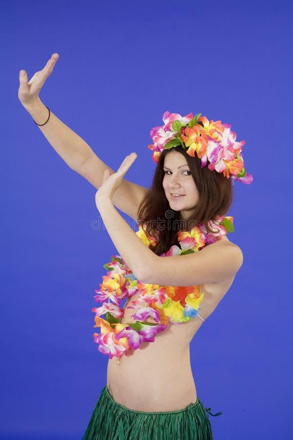 作为少年穿戴的女孩的hula 库存图片