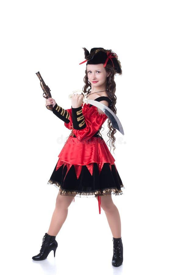 作为海盗打扮的俏丽的女孩,隔绝在白色 免版税库存照片