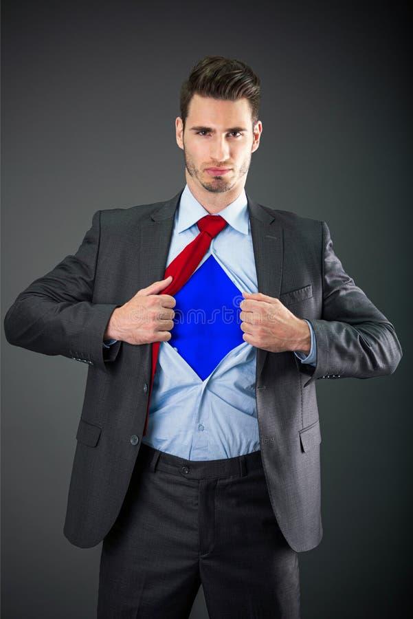 作为特级英雄的商人 免版税库存照片