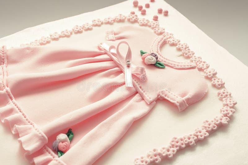作为生日蛋糕装饰的礼服 库存图片