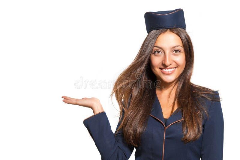 作为空中小姐打扮的一个美丽的少妇的画象 免版税库存图片