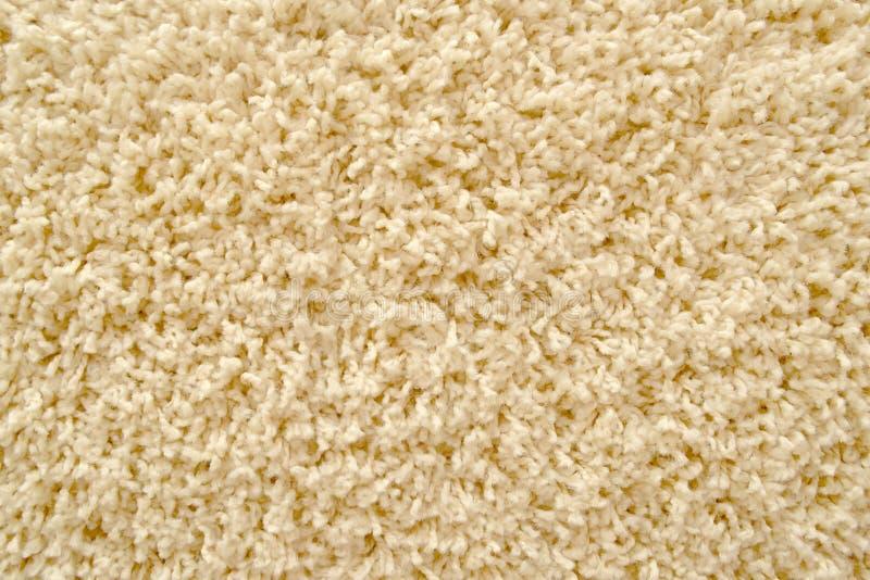 作为背景的米黄地毯texure 库存照片
