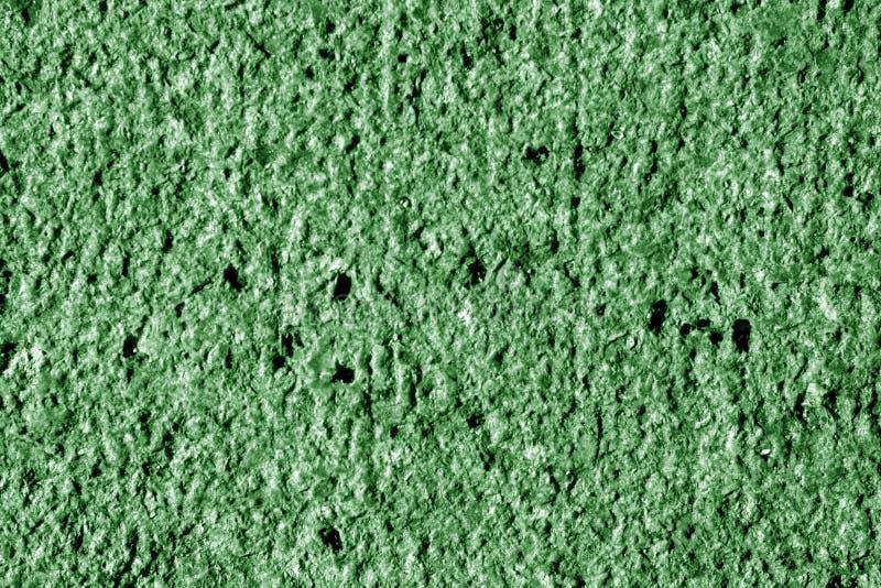 作为背景的花岗岩表面在绿色口气 库存照片