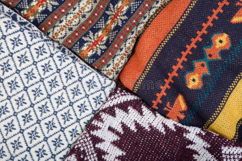 作为背景的被编织的冬天毛线衣 库存图片