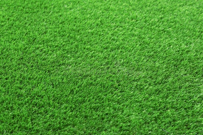 作为背景,特写镜头的人为草地毯 免版税图库摄影