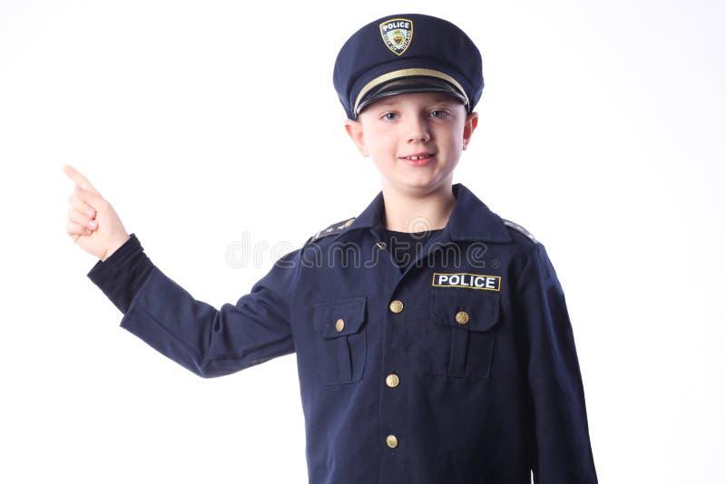 作为警察的年轻男孩 免版税图库摄影
