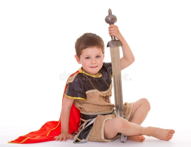 作为骑士打扮的小男孩 库存照片