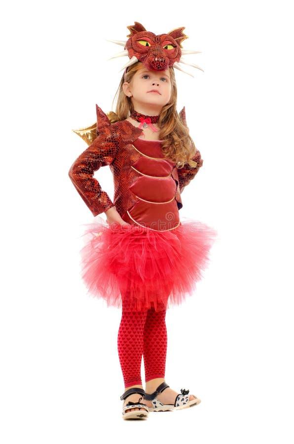 作为龙打扮的小女孩 免版税库存图片