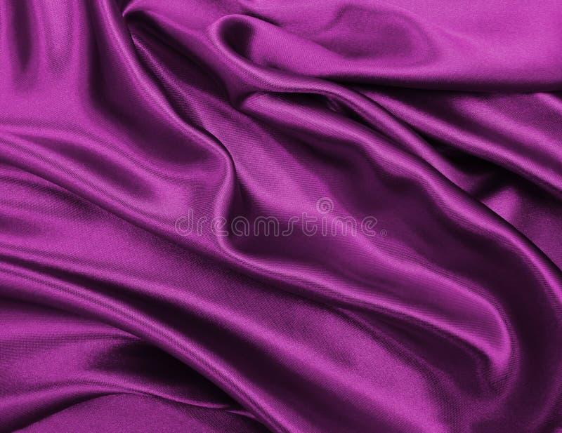 作为abstra的光滑的典雅的桃红色丝绸或缎豪华布料纹理 库存图片