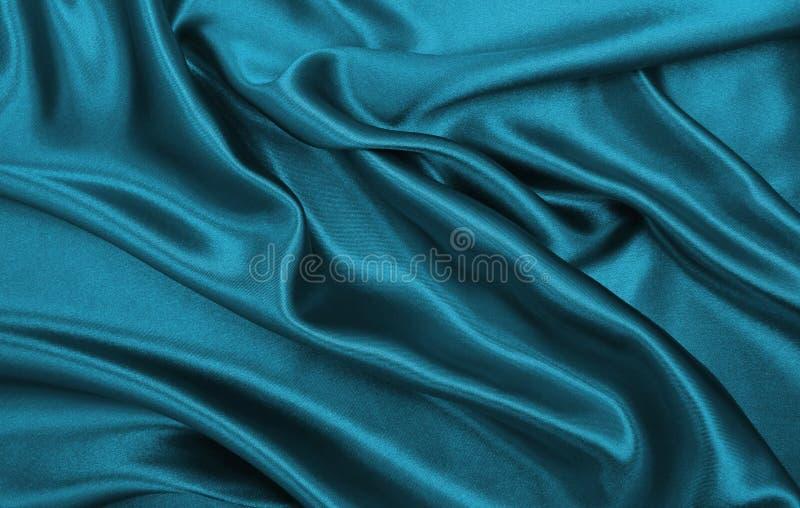 作为abstra的光滑的典雅的蓝色丝绸或缎豪华布料纹理 图库摄影
