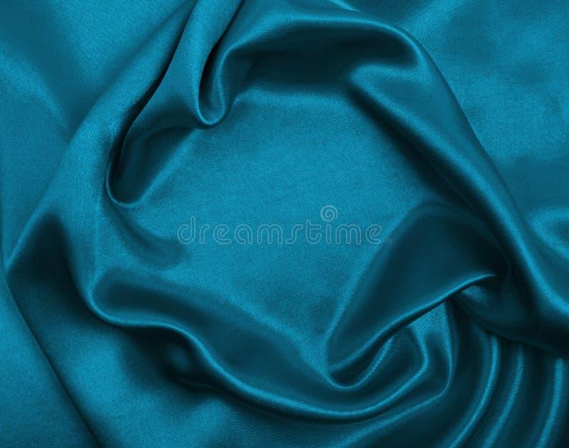 作为abstra的光滑的典雅的蓝色丝绸或缎豪华布料纹理 免版税图库摄影