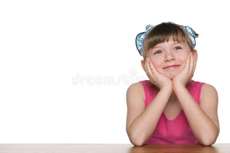 作书桌的小女孩 库存图片
