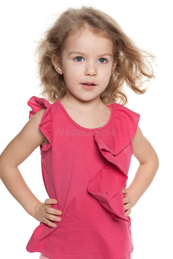 作反对白色背景的小女孩 库存图片