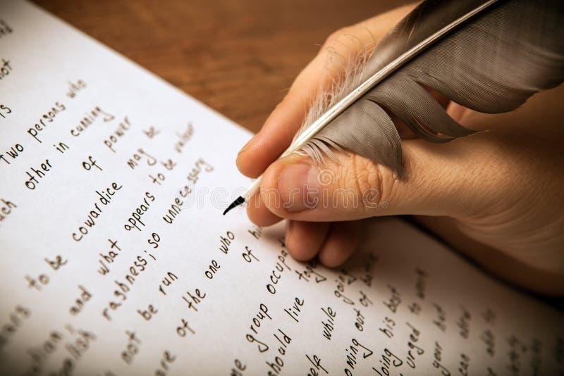 作家在文书工作写钢笔 库存照片