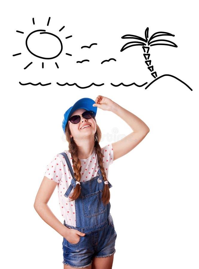 作梦关于假期的女孩的画象 库存照片