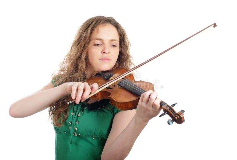 作用红头发人小提琴妇女 免版税库存图片