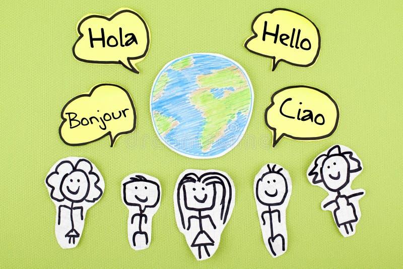 你好用不同的国际全球性外语Bonjour Ciao Hola 库存照片