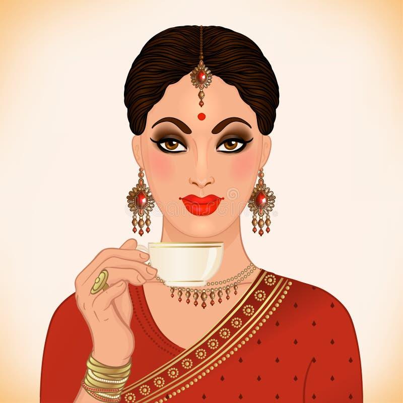 佩带传统成套装备饮用的茶的美丽的印地安妇女, 皇族释放例证