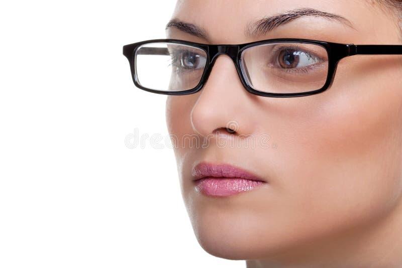佩带妇女的玻璃 免版税库存图片