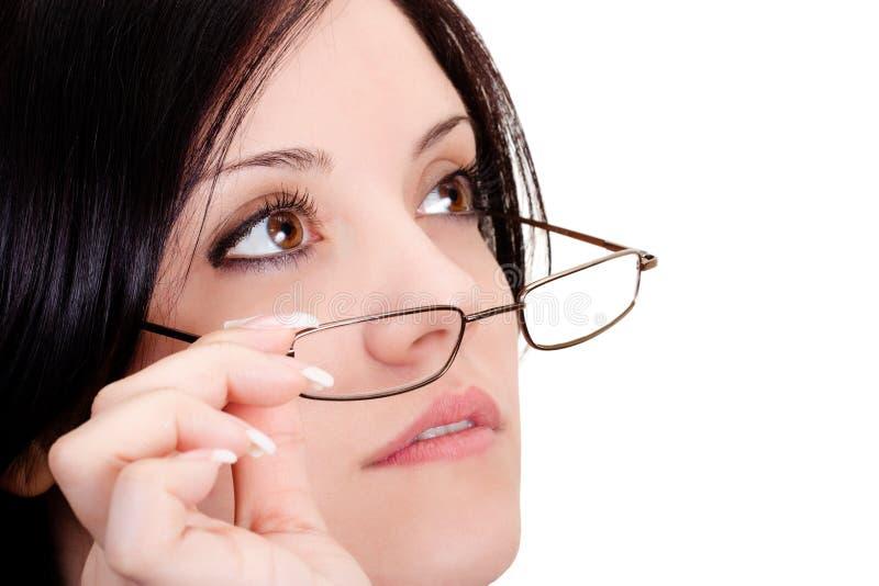 佩带妇女的玻璃 免版税库存照片