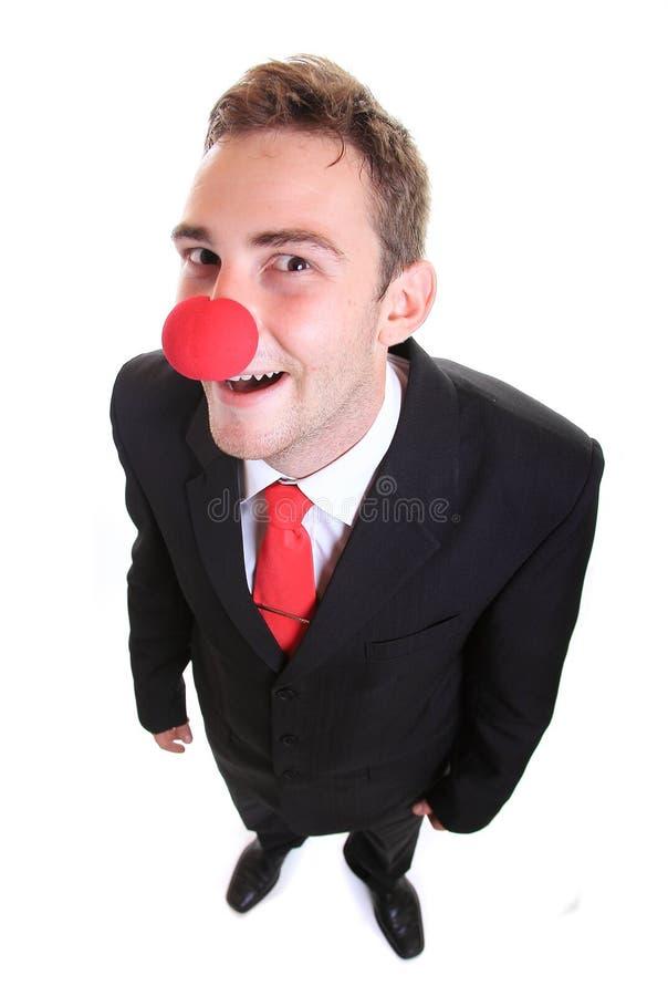 佩带小丑鼻子的商人 免版税库存照片