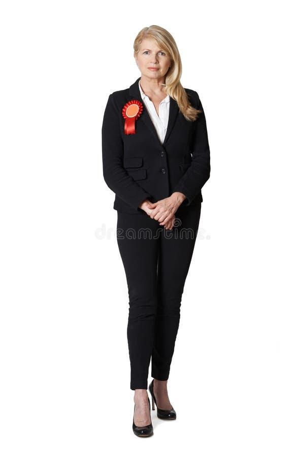 佩带红色玫瑰华饰的女性政客全长画象 免版税库存照片