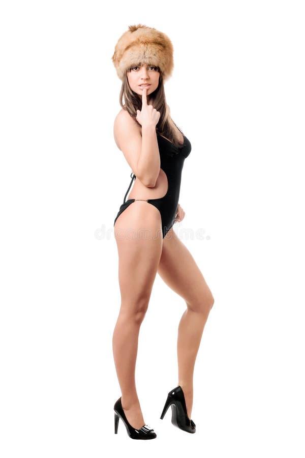 可爱的妇女佩带的泳装和毛皮盖帽 库存图片