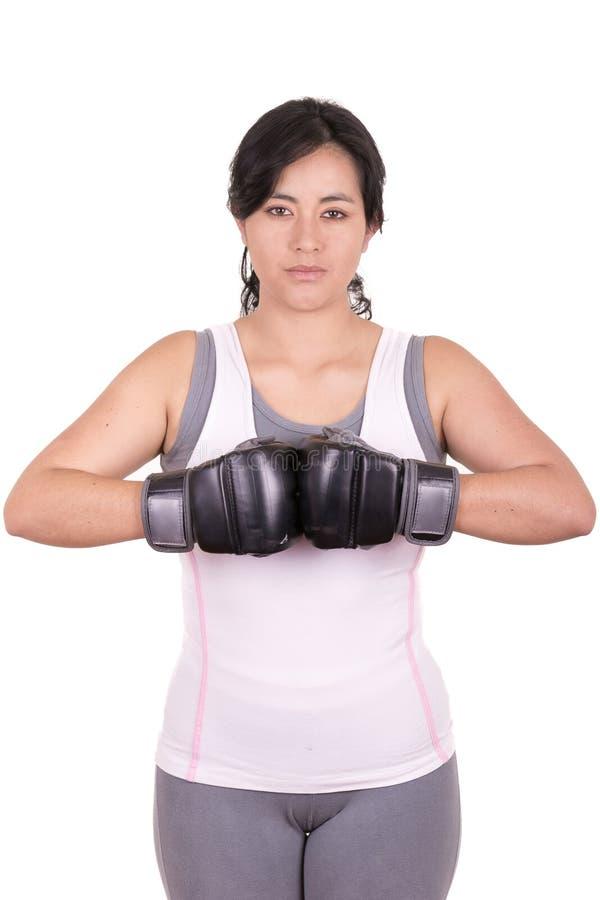 佩带MUTTAHIDA MAJLIS-E-AMAL的女性混杂的武术战斗机 库存图片
