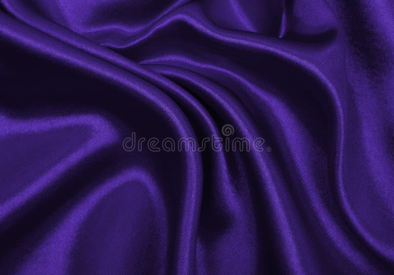 使典雅的淡紫色丝绸或缎豪华布料纹理光滑作为摘要 免版税库存图片