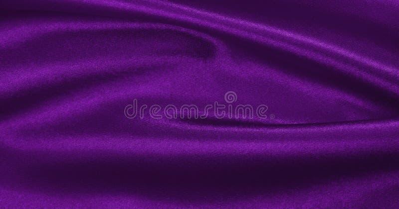 使典雅的淡紫色丝绸或缎豪华布料纹理光滑作为摘要 免版税库存照片