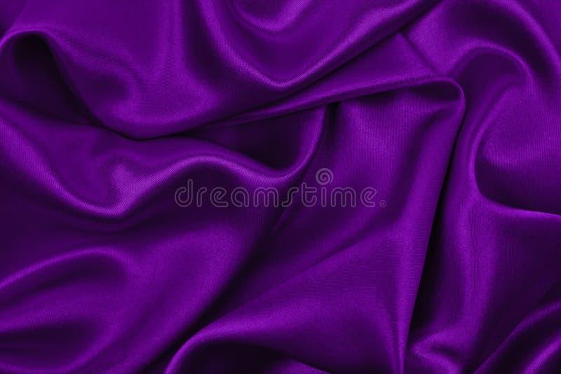 使典雅的淡紫色丝绸或缎豪华布料纹理光滑作为摘要 库存图片