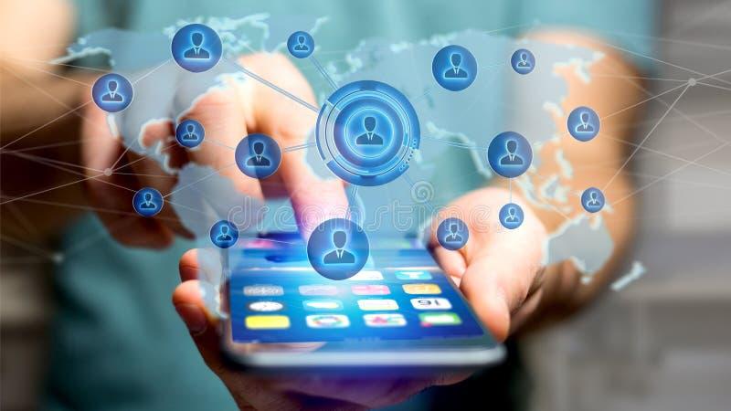 使用一个智能手机的商人有在被连接的w的一个网络的 库存图片