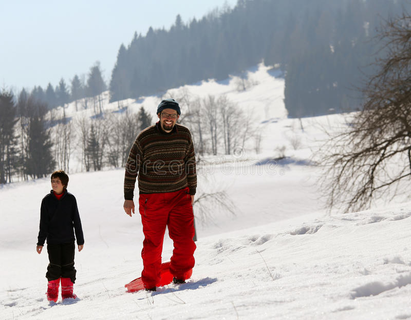 使用与在雪的突然移动在山 免版税库存照片