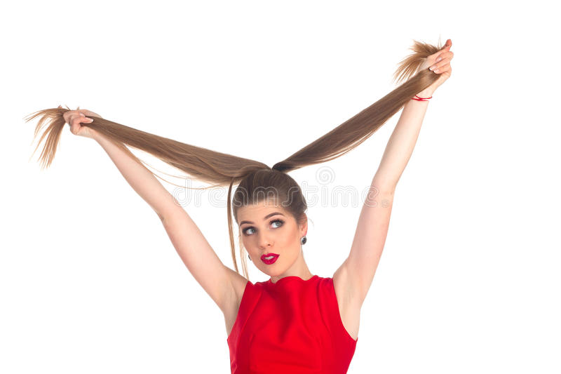 使用与她的头发的妇女 免版税图库摄影