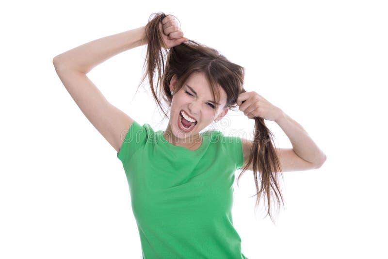 使用与她的头发的疯狂的女孩做鬼脸 库存照片