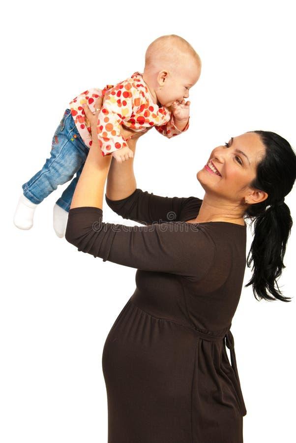 使用与婴孩的怀孕的母亲 图库摄影