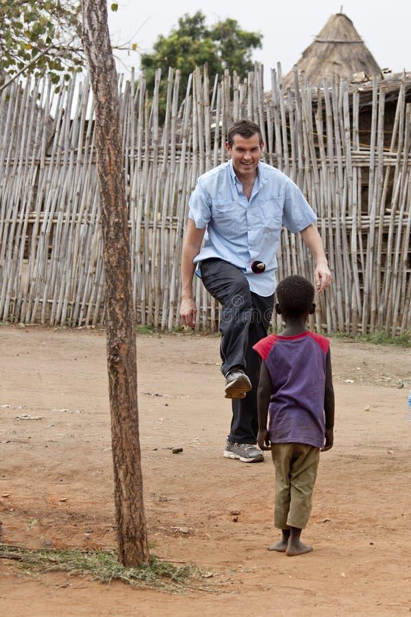 使用与孩子的传教士 免版税库存图片