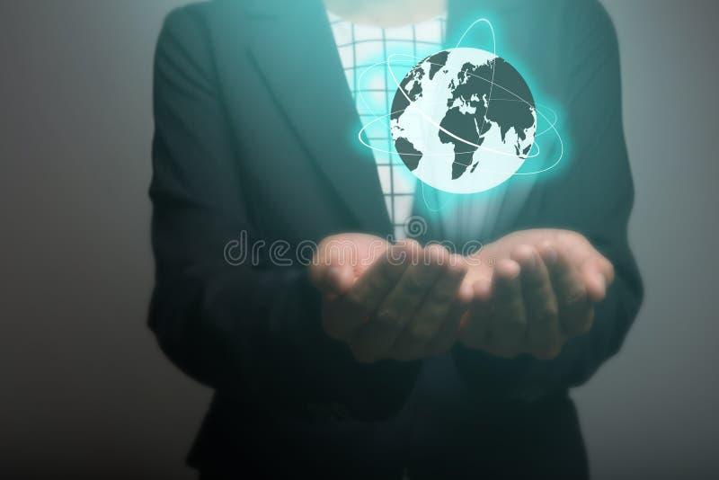 使用全球网络接口的女实业家在手 事务 图库摄影