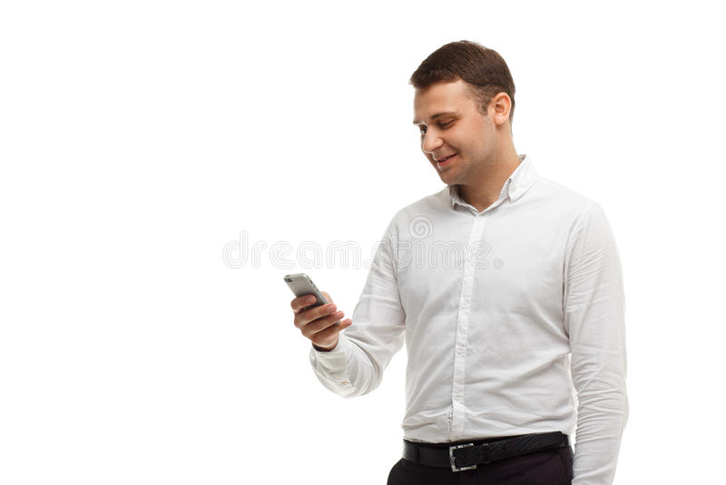 使用在白色隔绝的他的电话的商人 库存照片