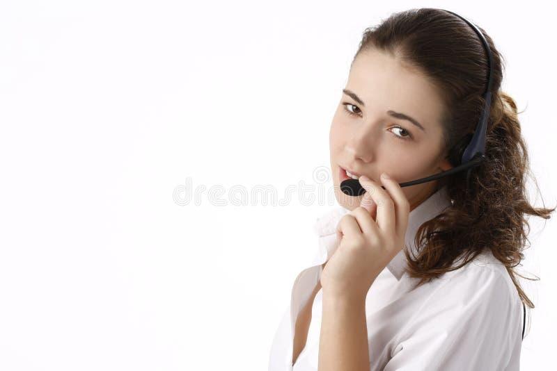 使用妇女年轻人的美丽的企业题头电&# 免版税库存照片