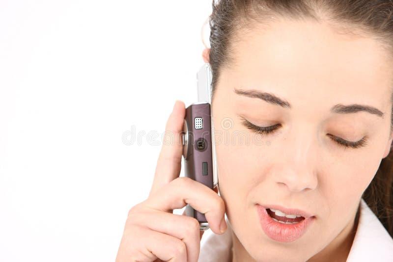 使用妇女的美丽的企业移动电话 免版税库存图片