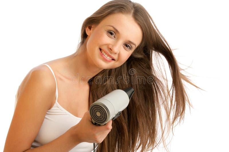 使用妇女的hairdryer 图库摄影