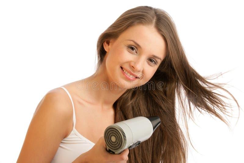 使用妇女的hairdryer 免版税图库摄影
