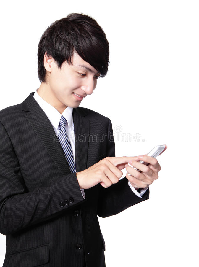 使用巧妙的电话的亚洲生意人 库存图片